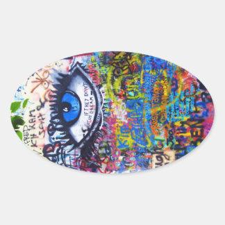 Ont öga för blåttgrafitti ovalt klistermärke