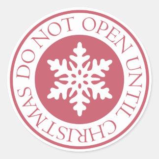 Öppna inte till den röda julsnowflaken runt klistermärke
