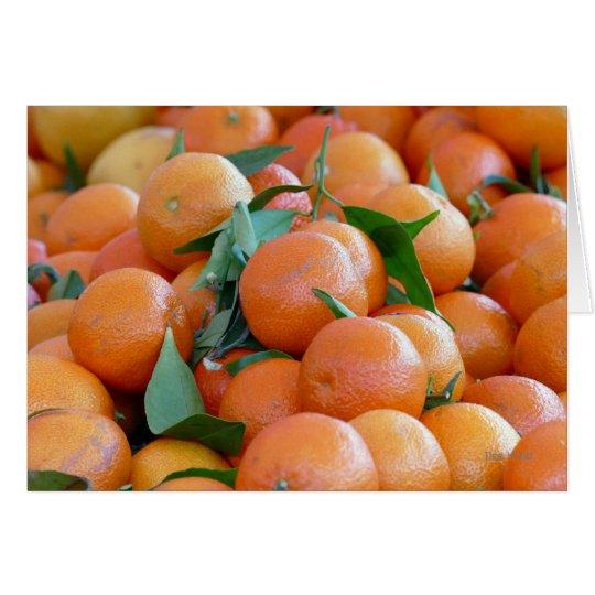 Orange clementines, tangerines and green leafs hälsningskort