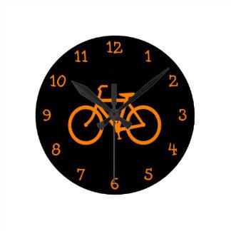 Orange cykel rund klocka