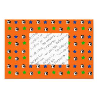 Orange fotbollbollar och stjärnor fototryck