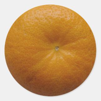 Orange fruktklistermärke runt klistermärke