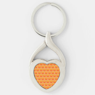 Orange honungskakamönster twisted heart silverfärgad nyckelring