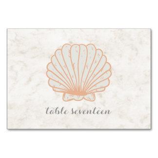 Orange lantligt snäckskalbröllopbord bordsnummer