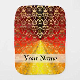 Orange och guld- damastast mönster bebistrasa