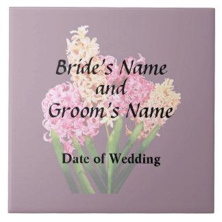 Orange och rosa hyacint som gifta sig produkter kakelplatta