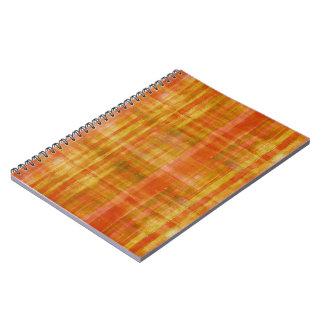 Orange randar anteckningsbok med spiral