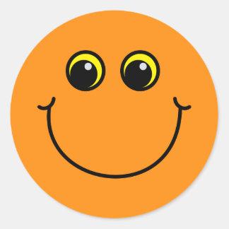 Orange smiley face runt klistermärke