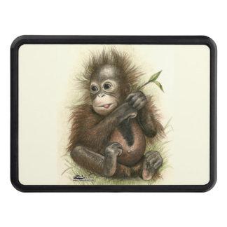 Orangutanbaby med löv dragkroksskydd