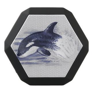 Orca som bryter igenom blått svart bluetooth högtalare