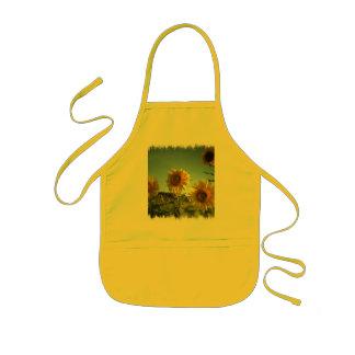 Organiskt trädgårds- solrosgultförkläde barnförkläde