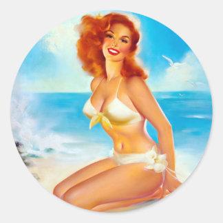 På stranden klämma fast upp runt klistermärke