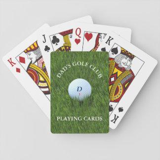 Pappa golfklubb som leker kort casinokort