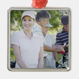 Par som förbereder sig att leka golf julgransprydnad metall