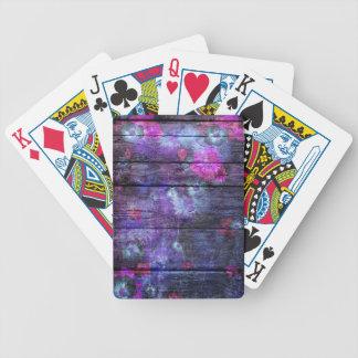 Pastellfärgad färgblomma på trä spelkort
