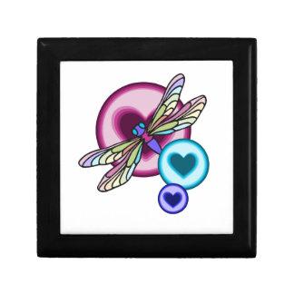 Pastellfärgad kulör slända med blåttrosor och minnesask