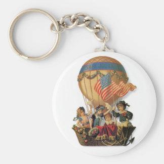 Patriotisk vintage, barn i en luftballong rund nyckelring