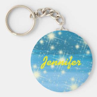 Personligblå himmel med glänsande stjärnor rund nyckelring