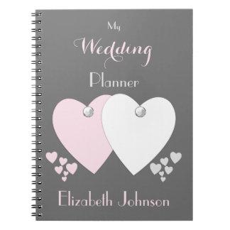Personligbröllopsfixarenrosor och grått anteckningsbok med spiral