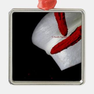 petal av en lilja med den röda stamenen julgransprydnad metall