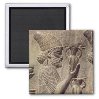 Phoenicianen som bär två som erbjuder, specificera magnet