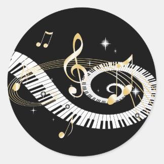 Pianonycklar och guld- musik noter runt klistermärke