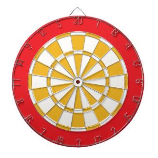 Pilen stiger ombord: Vit, guld och rött Darttavla