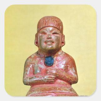 Placerad figur, eventuellt en som är tidigast fyrkantigt klistermärke