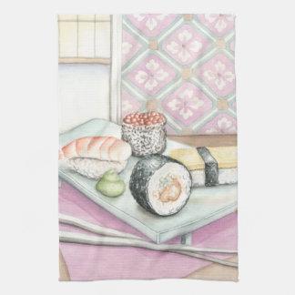 Plätera av blandade Sushi med pinnar Kökshandduk