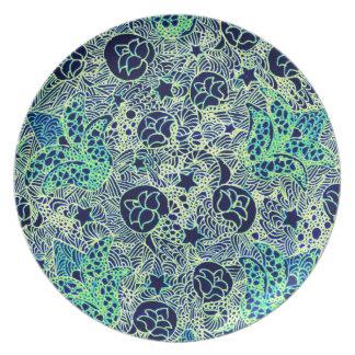 Pläterar den blom- designen för grönt och för dinner plates