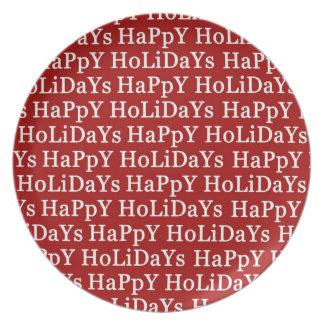 Pläterar den röda julmelaminen för glad helg tallrik