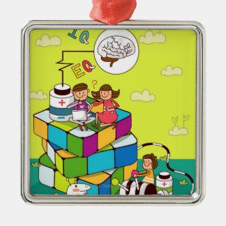 Pojke med en flickasitta på en Rubiks kubpussel Julgransprydnad Metall