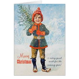 Pojke med en julgran Jenny Nyström CC0937 Hälsningskort