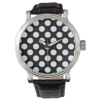 Polka dots på svart armbandsur
