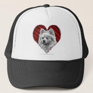 Pomeranian med hjärta keps