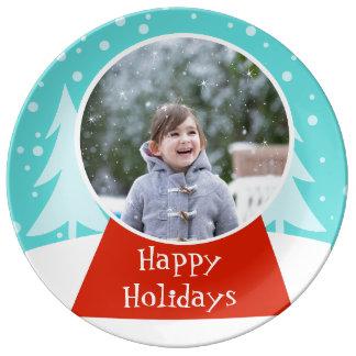 Porslin för fotoet för snöjordklothelgdag pläterar