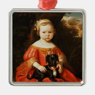 Porträtt av en flicka med en hund julgransprydnad metall