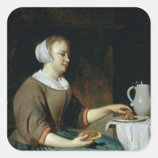 Porträtt av en flicka som placeras på ett bord fyrkantigt klistermärke