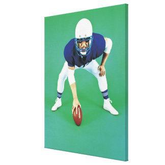 Porträtt av ett amerikanfotbollsspelareinnehav canvastryck
