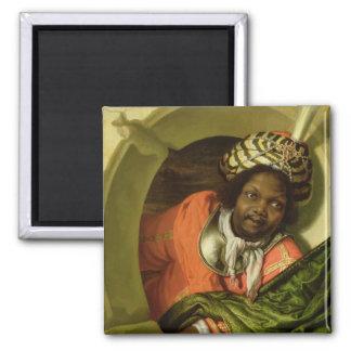 Porträtt av ett hedinnehav en flagga på ett fönste magnet