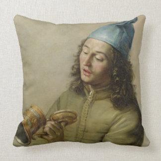 Porträtt av ett ungt maninnehav en tysk Gilttank Kudde