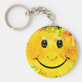 Precis en annan smiley face rund nyckelring
