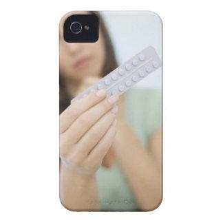 Preventiv- pills i en kvinna hand iPhone 4 cases