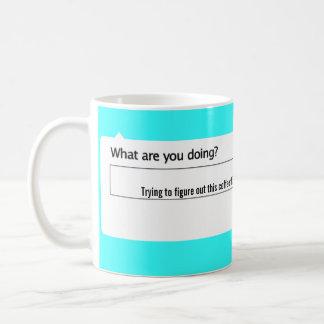 Pröva att figurera ut detta kaffeting kaffemugg