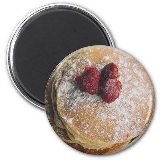 Pudrade pannkakor sockrar och hallonmagneten magnet