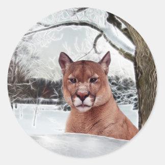Puma i snö runt klistermärke