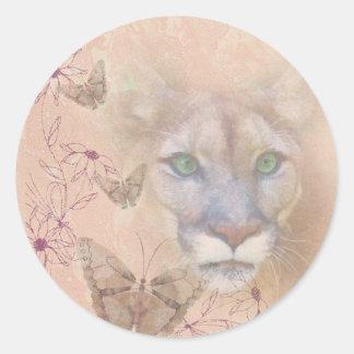 Puma och fjärilar runt klistermärke