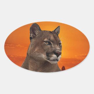 Puma på solnedgången ovalt klistermärke