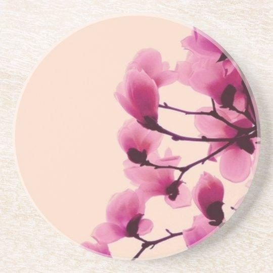 Purpurfärgade blommar underlägg för glas