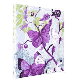 Purpurfärgade fjärilar på en gren canvastryck